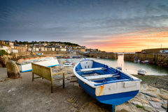 Sunrise at Mousehole in Cornwall. Sunrise over the harbour at Mousehole near Penzance on the Cornish coast Stock Photo