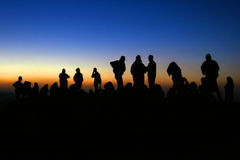 Sunrise at Mt Nemrut. People watching the sunrise on the top of Mt Nemrut, Eastern Turkey stock photo