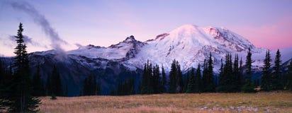 Sunrise Mt Rainier National Park Cascade Volcanic Arc. The morning sun just starting to hit the tip of Mount Rainier Royalty Free Stock Image