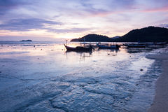 Sunrise by the muddy beach with boat in George Town, Penang Malaysia. Beautiful landscape series of sunrise and sunset collection from George Town, Penang Stock Photography
