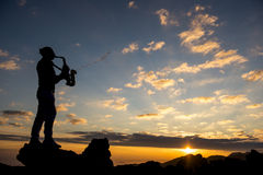 Sunrise musician and saxophone. The concept of an extraordinary beautiful music royalty free stock image