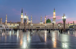 Sunrise Muslims gathered for worship Nabawi Mosque, Medina, Saud Royalty Free Stock Images