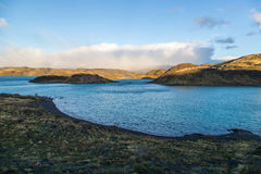 Sunrise in the National Park Torres del Paine, Patagonia, Chile. Sunrise over a beautiful blue lake in the National Park Torres del Paine, Patagonia, Chile Royalty Free Stock Photo