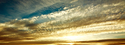 Sunrise nature background, clouds in morning sky Stock Images