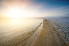Sunrise in a nature. Sea and beatifull beach with girl. Silence. Natural background. Sunlight Stock Photos