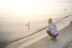 Sunrise in a nature. Sea and beatifull beach with girl. Silence. Natural background. Sunlight Stock Image