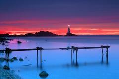 Sunrise near lighthouse royalty free stock photo