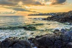 Sunrise near sea with crashing waves on the earth edge Stock Image