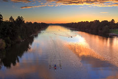 Sunrise Nepean River Penrith. Sunrise over the Nepean River at Penrith NSW, Australia.  Kayayers oars ripple the water reflections during dawn practice Stock Image