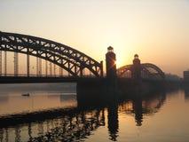 Sunrise on Neva river. Bolsheohtinskiy bridge (Saint-Petersburg Stock Photos
