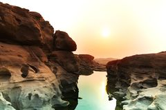 Sunrise new day at Sam Phan Bok, as known as the Grand Canyon of Thailand, the biggest rock reef in the Mae Khong River. In Ubon Ratchathani province, Thailand royalty free stock image