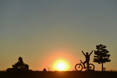 Sunrise and new excitement for cyclist Stock Image