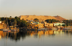 Sunrise on the Nile in Aswan. Beautiful sunrise on Nile in the City of Aswan in Egypt with a view on the Mausoleum of Mohammed Shah Aga Khan, the 48th Imam of stock images