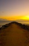 Sunrise at Noosa Breakwater. A beautiful sunrise and breakwater at Noosa Beach, Sunshine Coast, Queensland, Australia Royalty Free Stock Images