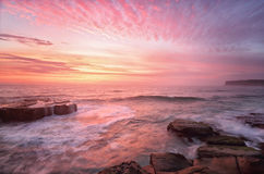 Sunrise from North Avoca Beach Australia. A very special summer sunrise with views from the rocks at North Avoca beach Stock Photography