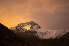 Sunrise on the north face of Mount Everest from Basecamp in Tibet. Early morning at the Everest Basecamp in Tibet. Sunrise gives Mount Everest Chomolungma a royalty free stock image