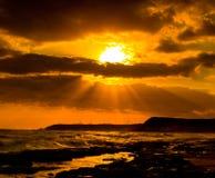 Sunrise on ocean. With dramatic sky Stock Photos