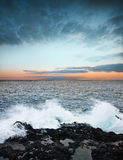 Sunrise and ocean. With waves Royalty Free Stock Image