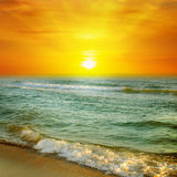 Sunrise on the ocean Stock Photography