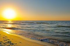 Sunrise on the ocean Stock Photos