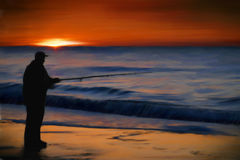Sunrise Ocean Fishing. Digital painting of a man shore fishing on a beach at the ocean as the sun rises in the background Stock Image