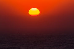 Sunrise Ocean New Day. Morning Sunrise colors over the ocean for a new day Stock Photography