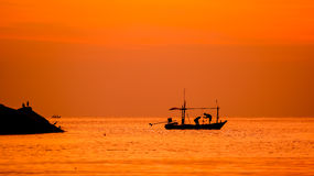 Sunrise in the ocean Stock Photography