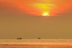 Sunrise in the ocean Stock Photos