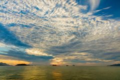 Sunrise Ocean View Nha Trang Vietnam. Nha Trang Vietnam sunrise with a cloudy blue sky over a turquoise ocean Stock Photos