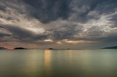 Sunrise Ocean View Nha Trang Vietnam. Nha Trang Vietnam sunrise with a cloudy grey sky over a turquoise ocean long exposure Royalty Free Stock Photo