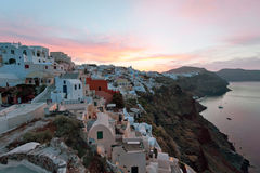Sunrise in Oia. Picturesque sunrise in Oia village, Santorini, Greece Stock Photo