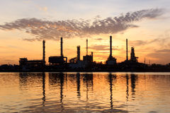 Sunrise, oil refinery factory with refection in Ba Royalty Free Stock Image
