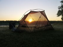 Sunrise on the Okavango delta. Tent and sunrise on the Okavango delta in Botswana Stock Photography