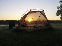 Sunrise on the Okavango delta. Tent and sunrise on the Okavango delta in Botswana stock photography