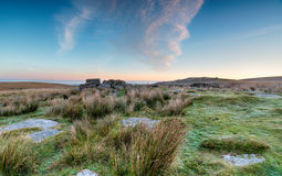 Sunrise at Okehampton Camp. Rugged moorland at Okehampton on Dartmoor National Park in Devon stock photography
