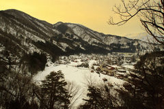 Sunrise in the old village. The sun rises from behind the hill village of Shirakawa, Japan Stock Photos