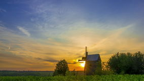 Sunrise and an Old Wooden Windmill. Time Lapse stock video