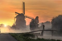 Sunrise On The Dutch Windmill Royalty Free Stock Image