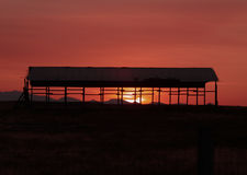Sunrise Through Open-Air Barn Stock Image