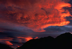 Sunrise orange clouds over mountains. Alaska, Denali National Park, Copyright David Hoffmann Royalty Free Stock Photography