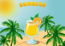Sunrise. Orange cocktail on the background of the sea, palm trees and sunrise Royalty Free Stock Photo