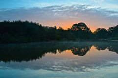 Sunrise at the Ornamental Pond, Southampton. Common, Hampshire, UK stock image