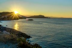 Sunrise out of the mountains in the background of the sea and islands. royalty free stock photography