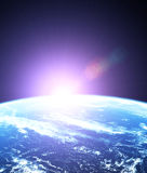 Sunrise outer space Stock Images