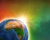 Sunrise over African Earth. Earth in deep space, focused on African continent, sunrise shining on the horizon. Elements of this image furnished by NASA - 3D Stock Photography