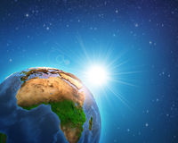 Sunrise over African Earth. Earth in deep space, focused on African continent, sunrise shining on the horizon. Elements of this image furnished by NASA - 3D Royalty Free Stock Photos