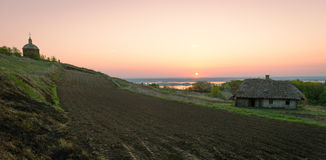 Free Sunrise Over Agricultural Land With Tillage, Old House, Wooden C Royalty Free Stock Photography - 70683577