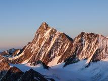 Sunrise over an alpine mountain landscape in Switzerland stock photos