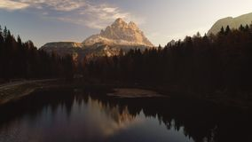 Sunrise over Alpine mountain peaks, forest and Braies Lake. Dolomiti Alps, South Tyrol