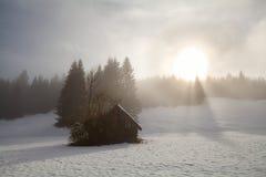 Sunrise over alpine snow meadow Stock Image